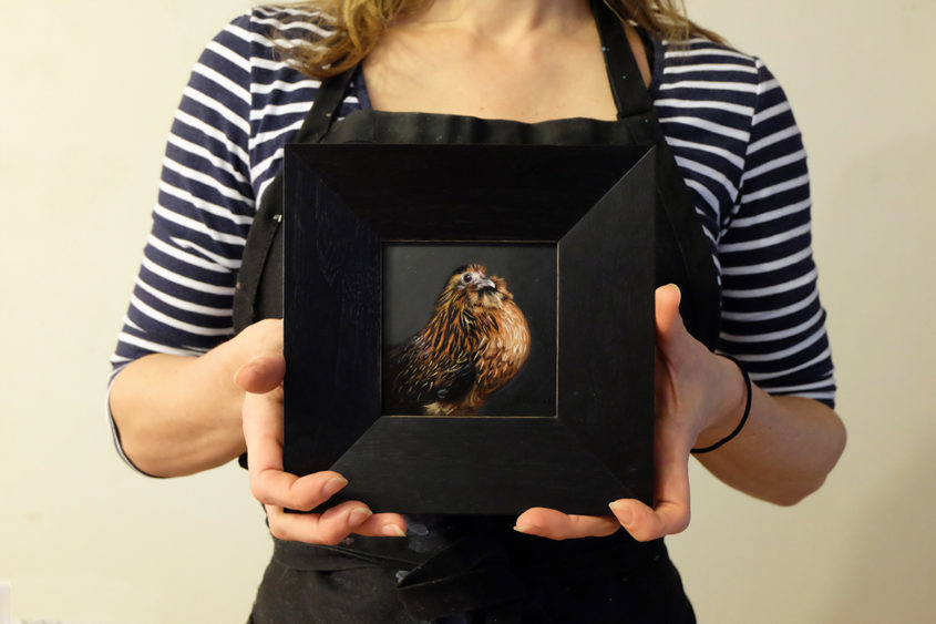 The artist Rebecca Luncan and her painting of a Chicken - May 2016 oil on copper