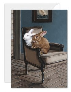 rabbits in chair greeting card