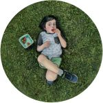 childrens portrait oil painting of boy laying on grass by seattle portrait artist Rebecca Luncan